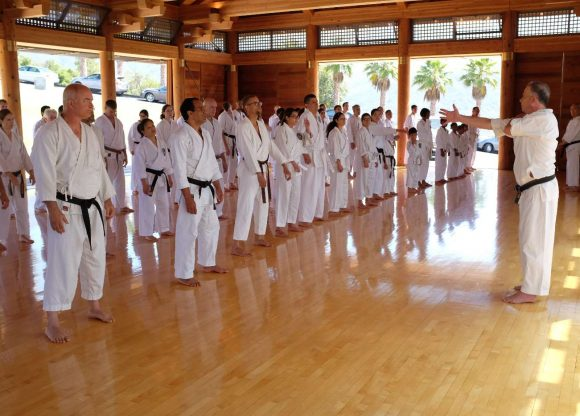 UNL SKA founder David Altman leading warmups at Shotokan Ohshima Dojo